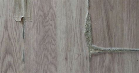 How can I fix oak laminate flooring that has swollen from